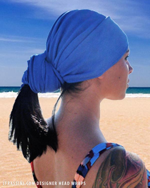 Enjoying the ocean breeze in an egyptian blue head wrap.